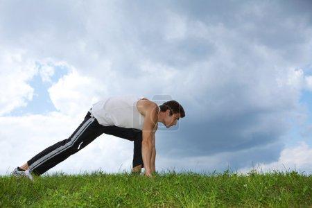 Man exercising in park