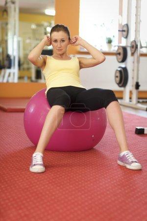 Woman Balancing On Swiss Ball