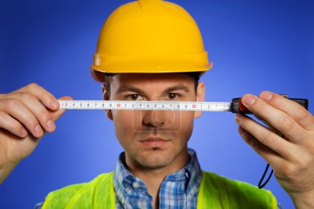 Architect holding tape measure