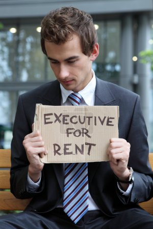 Businessman with executive for rent sign