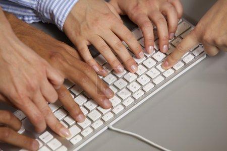 Photo for Human hands using computer keyboard - Royalty Free Image