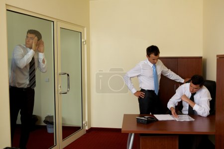 Photo for Businessman listening to  conversation  conversation between colleagues in office - Royalty Free Image