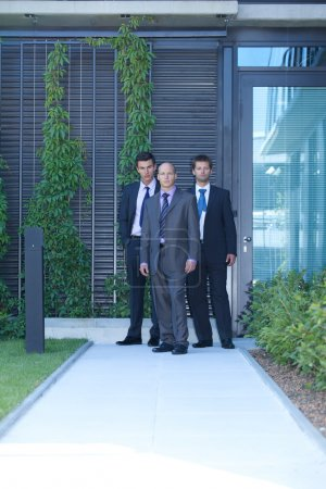 Photo for Portrait of three businessmen standing - Royalty Free Image