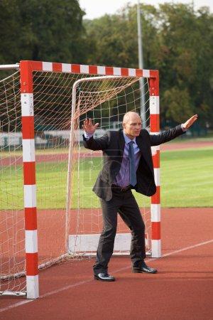 Businessman defending goal