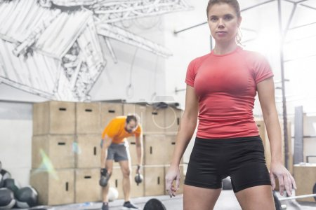 Photo for Portrait of confident woman standing in crossfit gym - Royalty Free Image