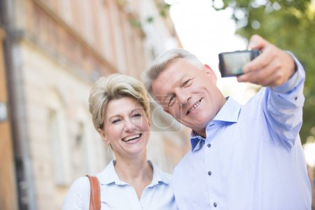 couple taking self portrait outdoors
