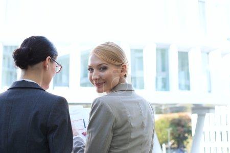 smiling businesswoman sitting