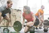 People weightlifting in  gym