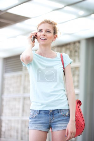 woman using cell phone outdoors