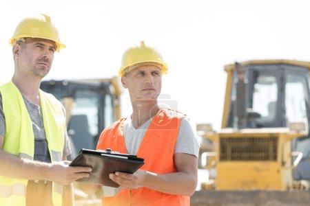 Engineers looking away