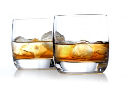 Glasses of whisky with ice