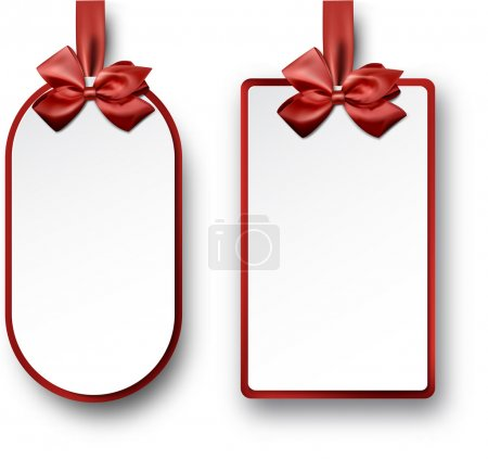 White paper gift cards with red satin bows.