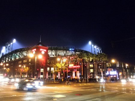 Outside AT&T Park at night as light shine into stadium during s