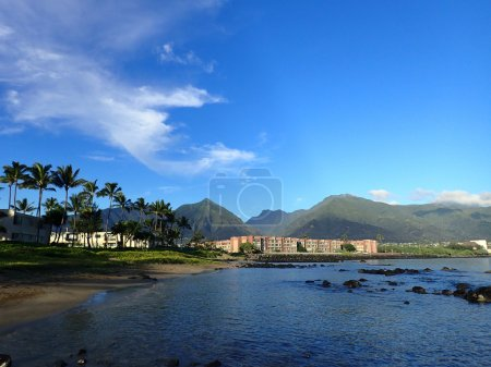 Kahului Bay with Hotel, coconut trees, and Iao Valley and surrounding mountains