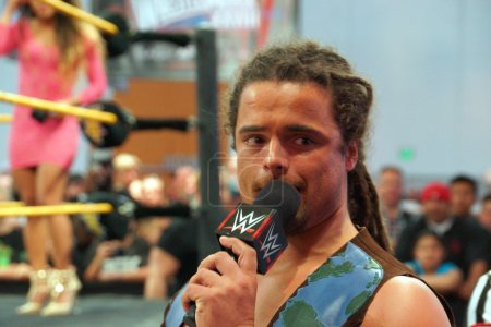 NXT Wrestle CJ Parker talks on mic outside ring to crowd