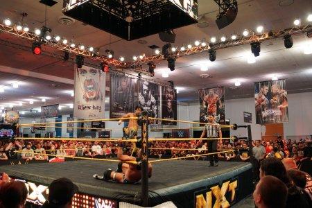 NXT Wrestle Hideo Itami jump kicks opponent in ring