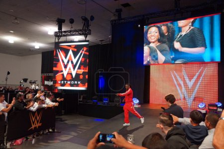 WWE Superstar Kofi Kingston walks towards ring and points