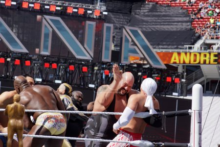 WWE Wrestler Big Show moves hand to slap chest of Los Matadores