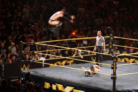 NXT male wrestler Finn Balor does Coup de Grace (Diving double