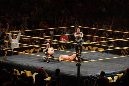 Ref points with both hands after NXT male wrestler Finn Balor be