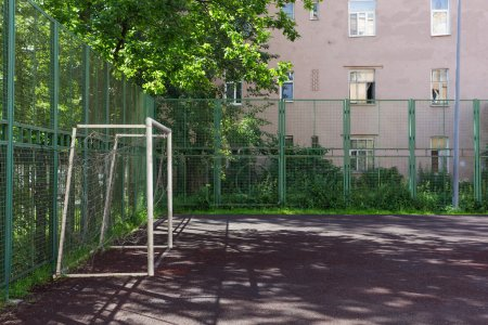 Soccer field with gates, fenced.