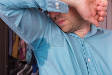 Photo for Problem with sweating. Wet clothes from the heat - Royalty Free Image