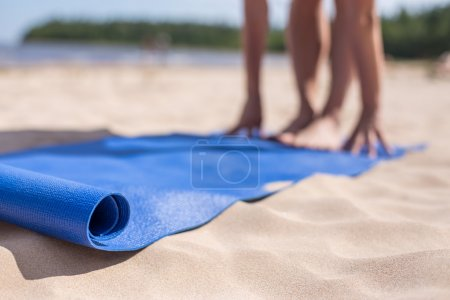 Photo for Blue mat and blurred in the background hands and feet - Royalty Free Image
