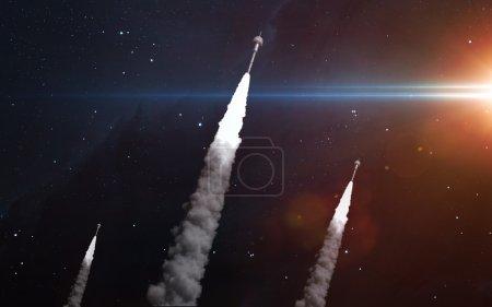 Photo pour Trois fusées dans l'espace. Éléments de cette image fournis par la Nasa - image libre de droit