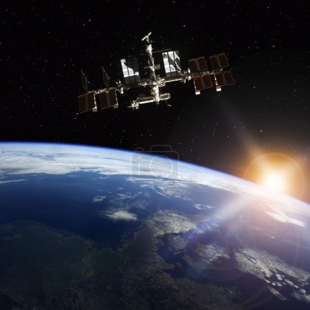 Photo pour Station spatiale en orbite autour de la terre. Éléments de cette image fournie par la Nasa - image libre de droit