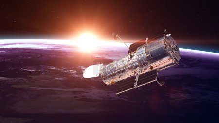The Hubble Space Telescope in orbit above the Eart...