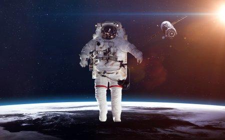 Photo pour Astronaute dans l'espace dans le contexte de la planète terre. Éléments de cette image fournie par la Nasa - image libre de droit