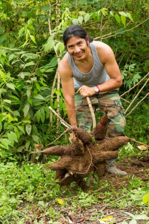 Indigenous Man With Cassava Roots
