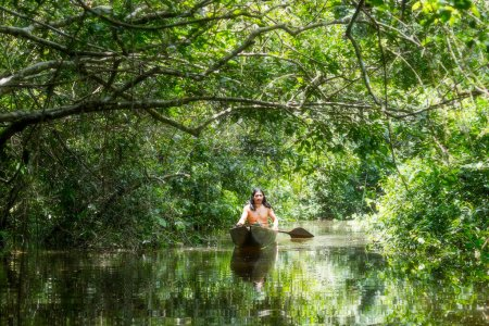 Indigenous Man With Canoe In Amazon Basin