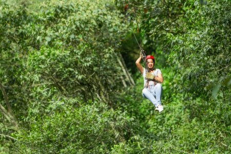 Photo for Young Woman On Zip Line - Royalty Free Image