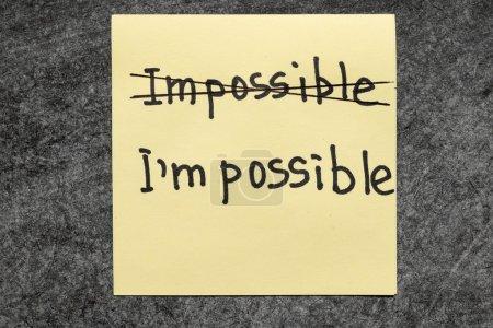 Photo pour Impossible - Je suis possible concept manuscrit sur note de papier jaune - image libre de droit