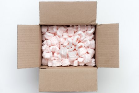 Photo for Carton packing box wide open with pink packaging filling inside - Royalty Free Image