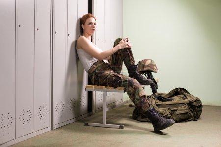 Military woman at locker room