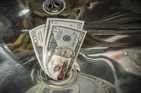 Photo for Dollars, Money Down the Drain - Royalty Free Image