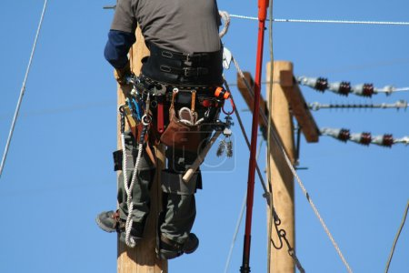 An electrical lineman apprentice working