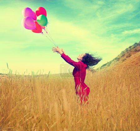 Girl walking in a field