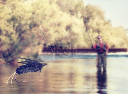 Person fly fishing in a river