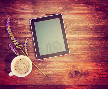 Photo for Digital tablet computer on wooden table with cup of coffee - Royalty Free Image