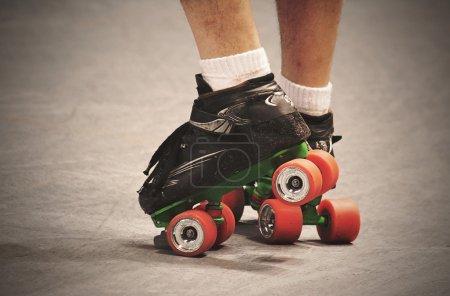 Pair of legs in roller skates