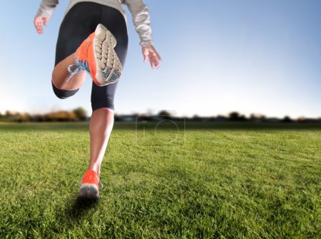 Athletic pair of legs on grass