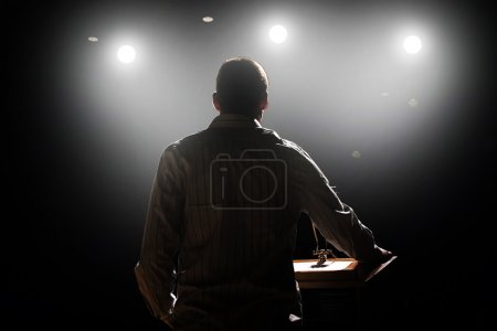 Photo for A young man in front of a podium and an audience - Royalty Free Image