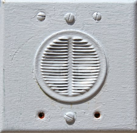 Close-up of building intercom on a wall
