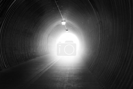 Black and white tunnel with lighting...