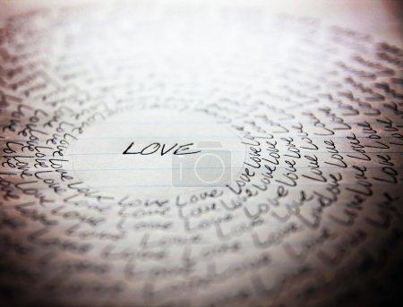 Word love written on lined paper