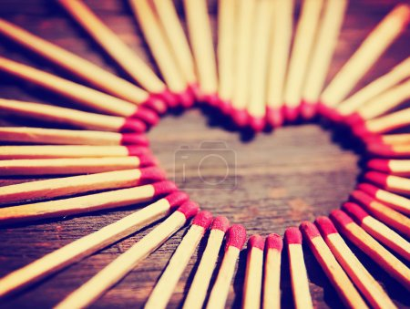 Photo for Matchsticks in the shape of a heart toned with a warm retro vintage instagram filter effect - Royalty Free Image