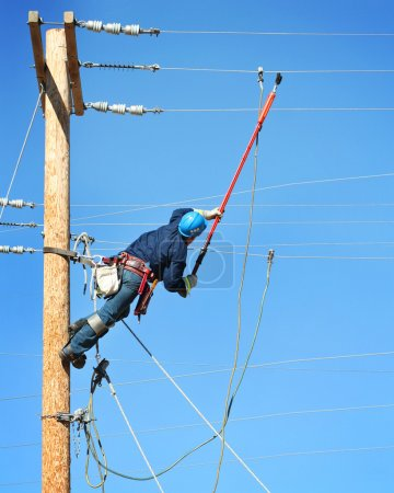 Electrical lineman working